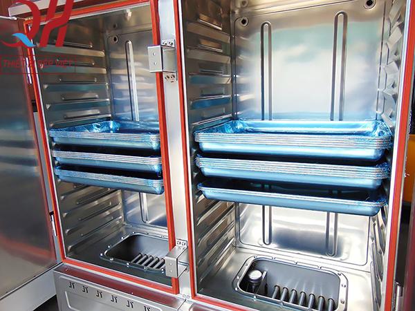 Hệ thống thanh gia nhiệt và buồng chứa nước của tủ cơm công nghiệp 24 khay bằng gas